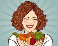 Härlig rödhårig dam med grönsaker i hans händer Royaltyfri Foto