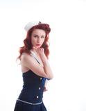 Härlig retro utvikningsflicka i en sjömanstilklänning Arkivfoton