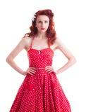 Härlig retro utvikningsflicka med den röda prickklänningen Fotografering för Bildbyråer