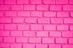Härlig rosa färg av tegelstenväggen Arkivbild