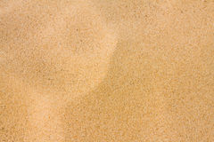 härlig sand för bakgrund arkivfoton