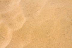 härlig sand för bakgrund Arkivfoto