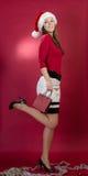 Härlig santa kvinna som rymmer en röd påse royaltyfria foton