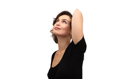 härlig seende stående som ler upp kvinna Arkivbild