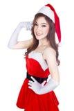 Härlig sexig kvinna som bär Santa Claus kläder och att tänka Arkivfoto
