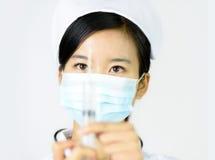 Härlig sjuksköterska på en vit isolerad bakgrund Royaltyfria Foton
