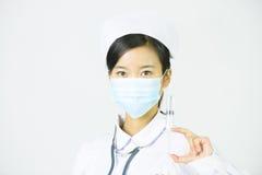 Härlig sjuksköterska på en vit isolerad bakgrund Royaltyfria Bilder