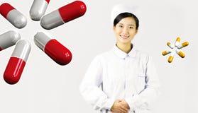 Härlig sjuksköterska på en vit isolerad bakgrund Arkivbilder