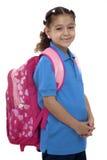 Härlig skolaflicka med ryggsäcken Royaltyfri Bild