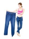 Härlig slank ung kvinna med stor jeans royaltyfria bilder