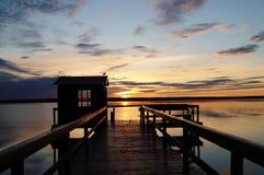 Härlig solnedgång över den stora sjön för hamn Arkivfoto