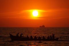 Härlig solnedgång på stranden Mangalore Royaltyfria Foton