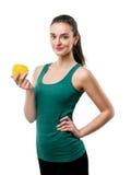 Härlig sportig kvinna med äpplet Arkivbild