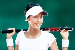 Härlig sportswoman med racket Arkivfoton