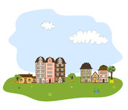 Härlig by, stad eller grannskap på gräsplanH Arkivfoto