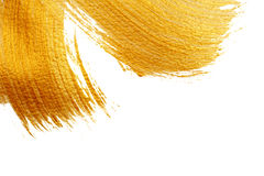Härlig stor abstrakt guld- bakgrund med akrylmålarfärgborsten på vit bakgrund fotografering för bildbyråer