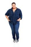 Stor kvinna i jeans Arkivbild
