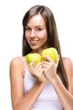 Härlig sund livsstil -, rymmer den naturliga kvinnan ett äpple två Royaltyfri Foto