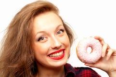Härlig tonåring med donuts Royaltyfri Foto