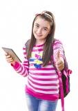 Härlig tonåringflicka med ryggsäcken och den digitala minnestavlan royaltyfria foton