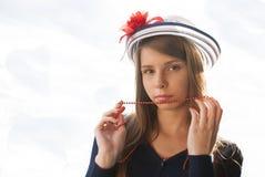 Härlig tonårs- flicka i hatt Arkivbild