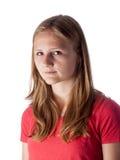 Härlig tonårs- flicka som allvarligt ser in i kameran Fotografering för Bildbyråer