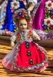 Härlig traditionell handgjord docka och färgrik kjol Arkivfoto