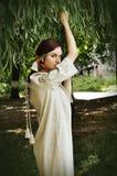 Härlig ukrainsk flicka på trädgården Fotografering för Bildbyråer
