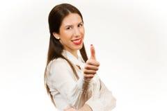 Härlig ung affärskvinna, med hennes tumme upp Arkivbilder