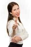 Härlig ung affärskvinna, med hennes tumme upp Royaltyfri Fotografi