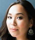 Härlig ung asiatisk kvinnaframsida för Closeup fotografering för bildbyråer