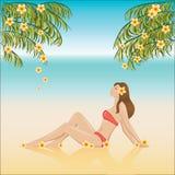 Flicka som kopplar av på en strand Arkivfoto