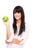Härlig ung brunettkvinna med äpplet på vit bakgrund Fotografering för Bildbyråer