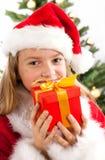 Härlig ung flicka i Santa Claus kläder Royaltyfria Bilder