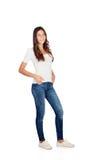 Härlig ung flicka med jeans Fotografering för Bildbyråer
