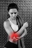 Härlig ung konditionkvinnakänsla smärtar Arkivbilder