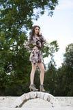 Härlig ung kvinna i brun klänning royaltyfria bilder
