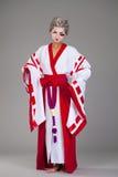 Härlig ung kvinna i den vita kimonot Royaltyfria Foton