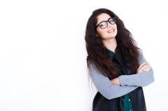 Härlig ung kvinna i exponeringsglas Arkivfoto