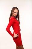Härlig ung kvinna i röd klänning Arkivbild