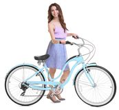 Härlig ung kvinna med cykeln arkivbild