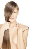 Härlig ung kvinna med långt blankt hår royaltyfria foton