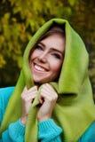 Härlig ung kvinna som täcker hennes huvud royaltyfri fotografi