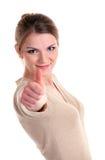 Härlig ung kvinna som visar tumen upp tecken Royaltyfria Foton