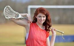 Härlig ung kvinnlig lacrossespelare royaltyfria bilder