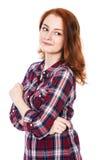 Härlig ung rödhårig flicka som ser till sidan royaltyfri bild