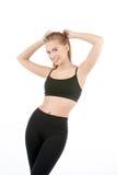 Härlig ung sportig muskulös kvinna som isoleras mot vit bakgrund royaltyfri bild