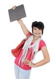Härlig ung student som rymmer en bok Royaltyfri Fotografi