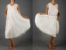 Härlig vit klänning med den orientaliska prydnaden Arkivfoto
