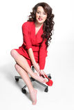 Härlig flicka i en röd klänning royaltyfria foton